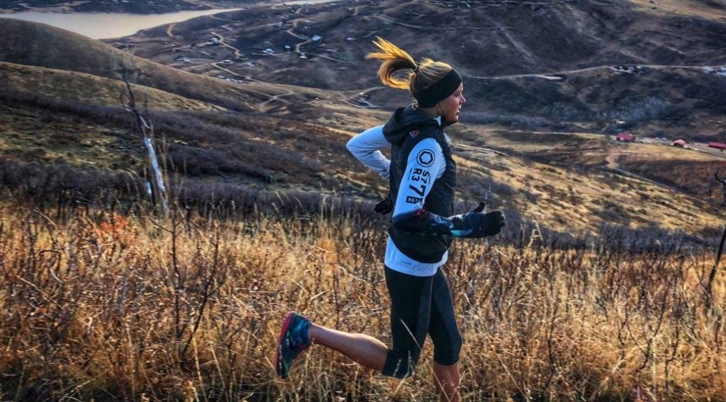 Amelia Boone running in a field
