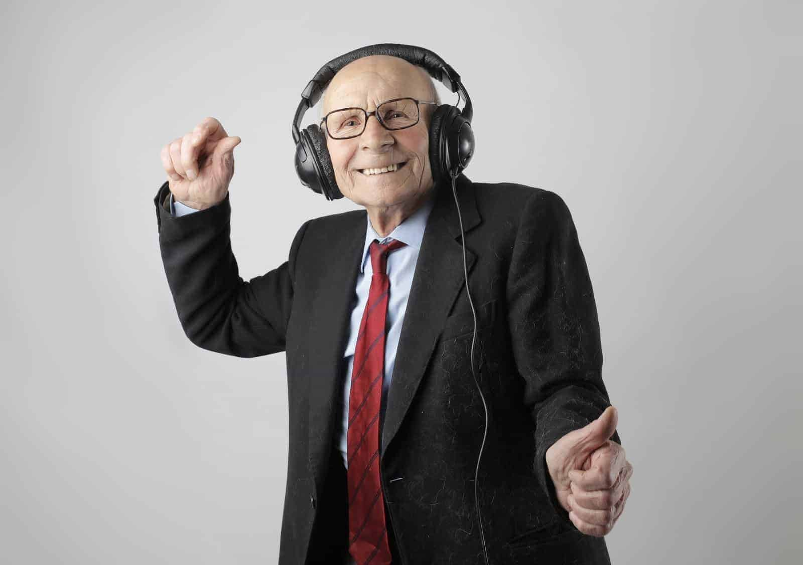 Older guy dancing with headphones on as part of a section on whether intermittent fasting helps with longevity.