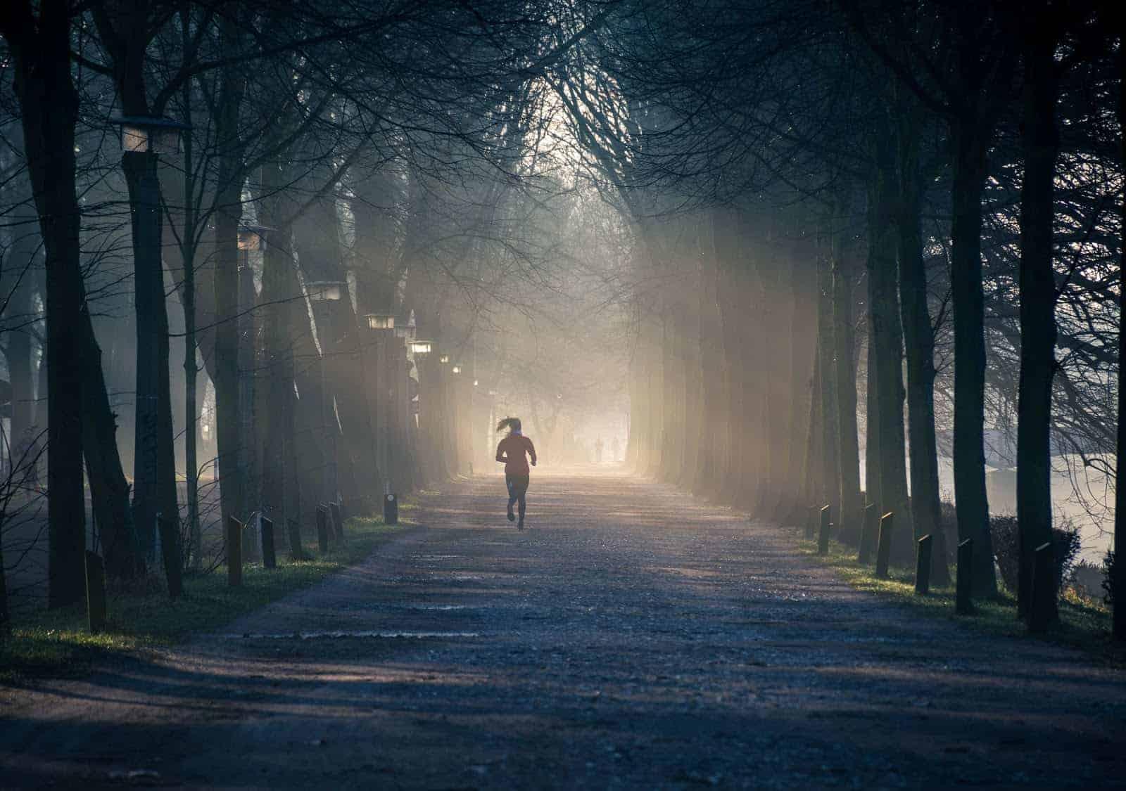 Woman running down a path