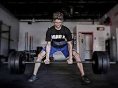 Kid deadlifting