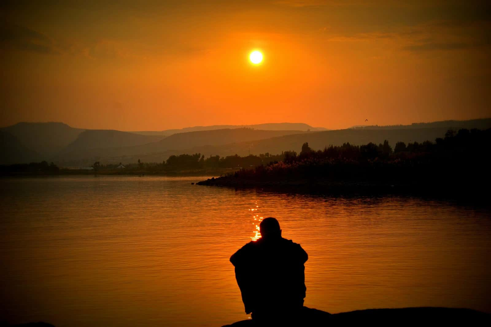 Man viewing beautiful sunset