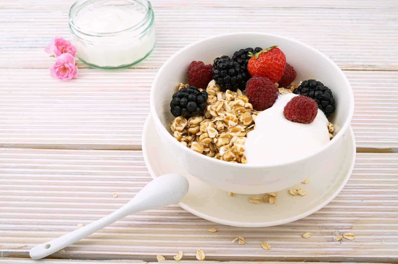Healthy-looking bowl of fruit and yogurt.