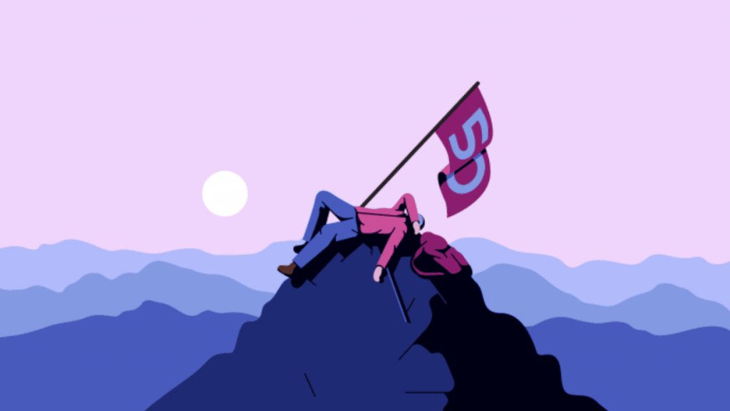 Guy on a mountain with 50 flag
