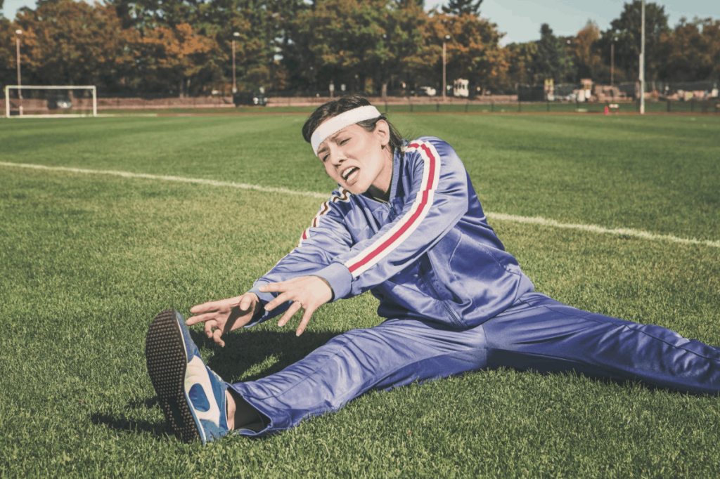Guy stretching on grass