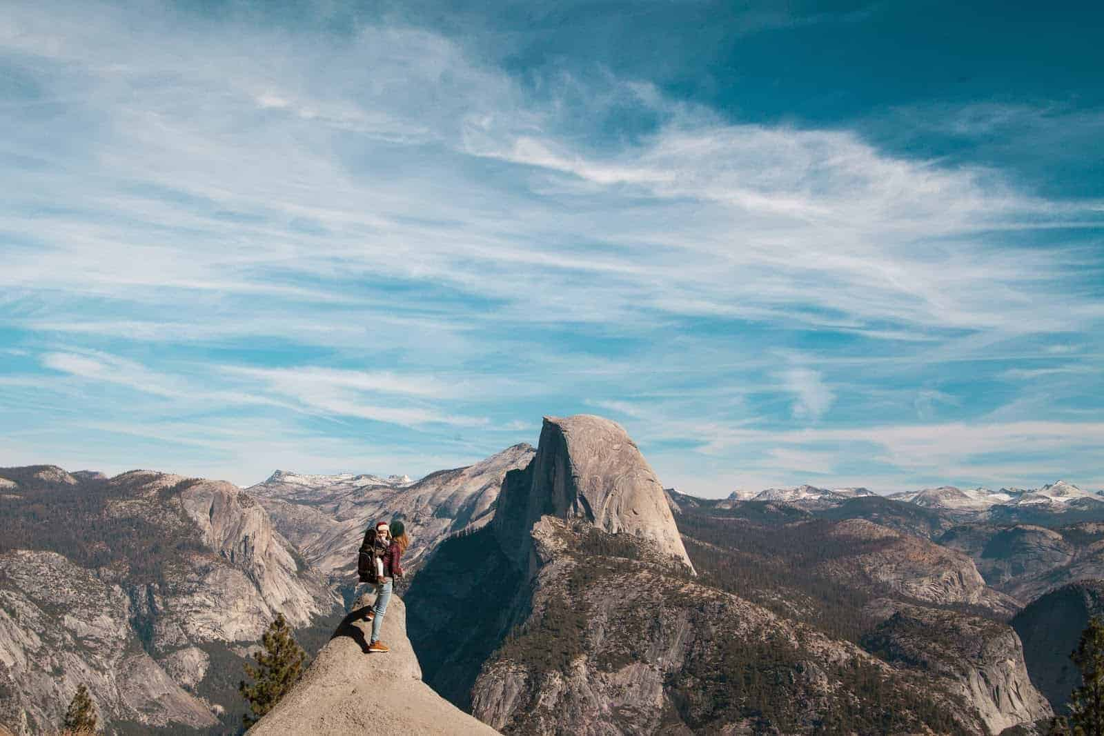 Person on mountaintop near Half Dome in Yosemite