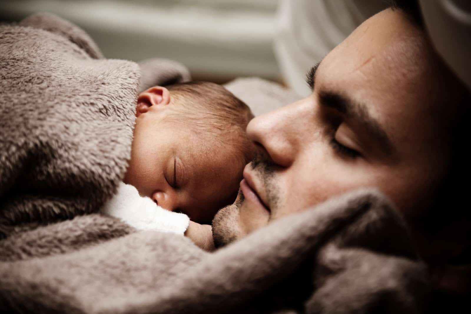 Man and child sleeping
