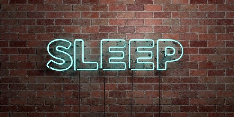 Sleep neon sign to emphasize the role of sleep in building muscle at any age