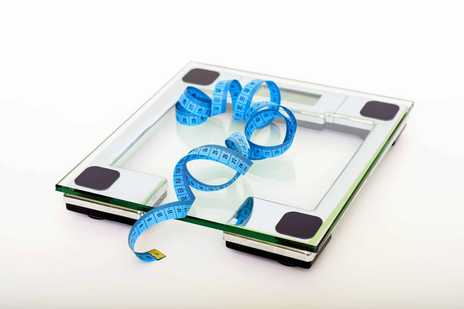 Scale and measuring tape to demonstrate whether intermittent fasting can help you lose weight.