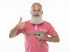 Older mad with a measuring tape around his chest to demonstrate fat loss over fifty