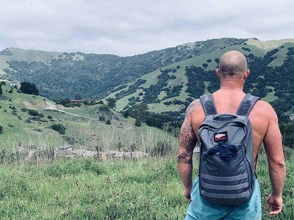 Kelly with a GoRuck pack on for gift guide