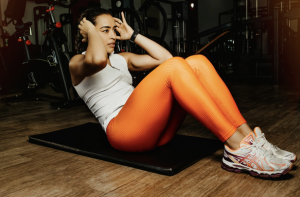 Woman doing a sit up to represent the athletic performance benefits of caffeine