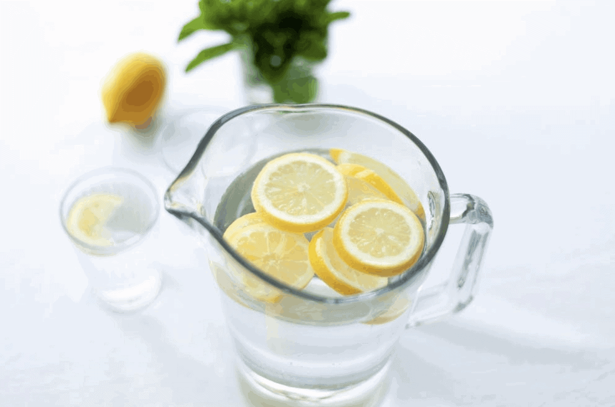 Pitcher of lemon water to illustrate the need for hydration
