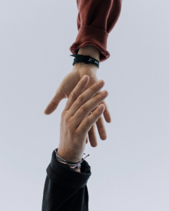 Two hands holding to represent community and altruism