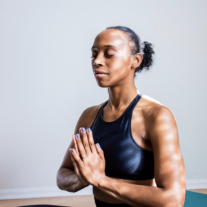 Woman meditating to decrease cortisol