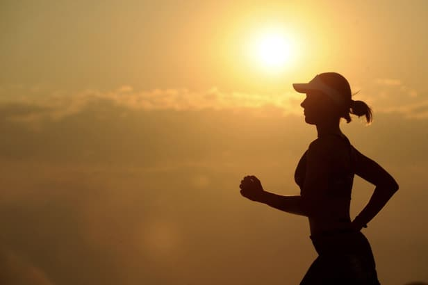 Woman running to illustrate the need for athletes to supplement with electrolytes