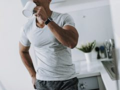 Fit man drinking a cup of coffee to illustrate the performance enhancing benefits of caffiene