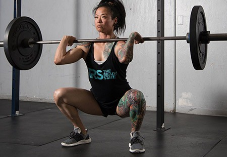 Image of woman weightlifting to demonstrate one of the ways I prepare for menopause