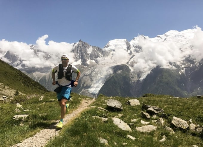 Athletic man running in the mountains to demonstrate how to accomplish your fitness goals