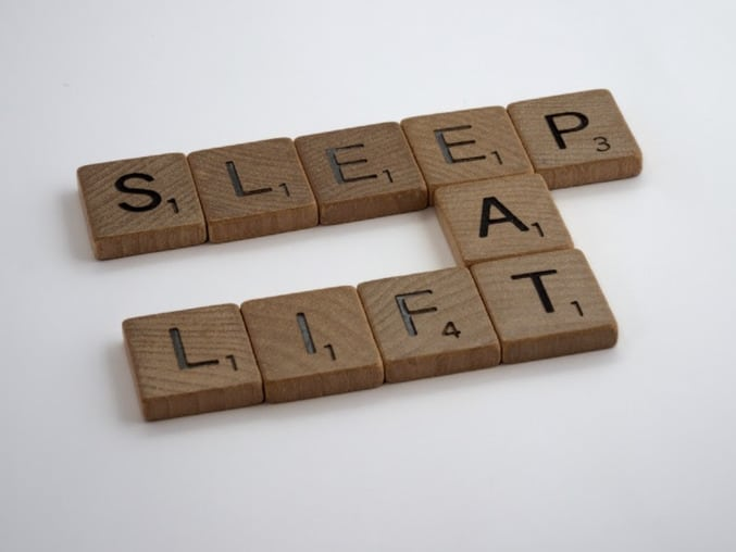 Scrabble tiles that say eat, sleep, lift to demonstrate how to accomplish your fitness goals