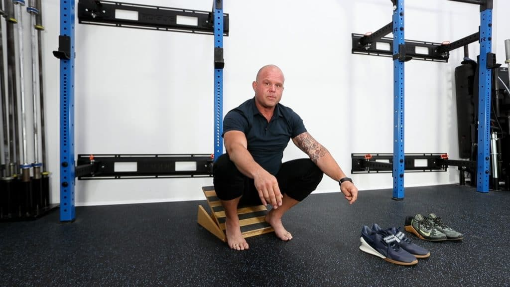Image of Kelly squatting on a slant board to demonstrate how to use a slant board properly